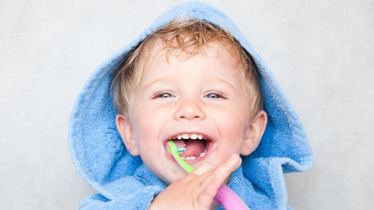Child Brushing Teeth | Buxton Family Dental